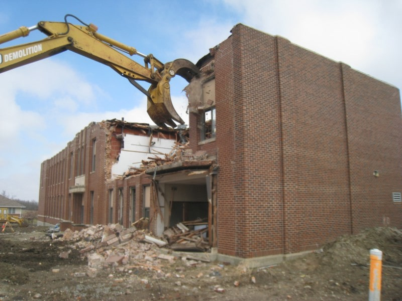 Demolishing a brick building