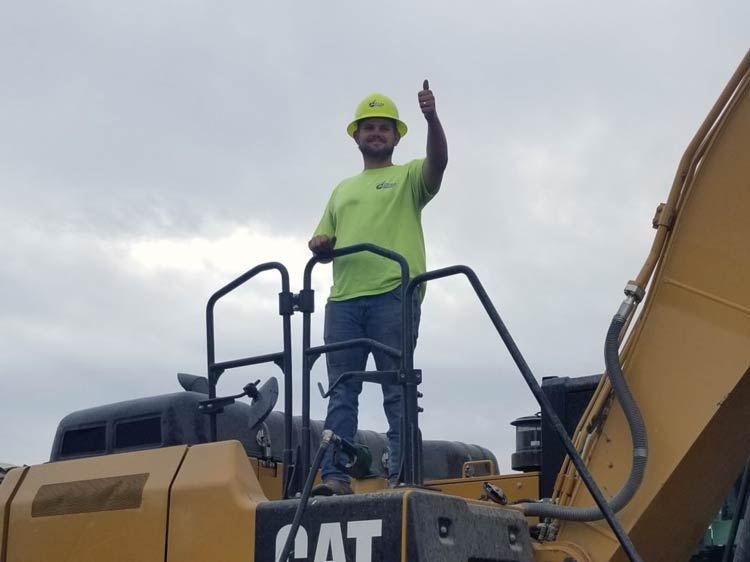 Employee with thumbs up at demolition site